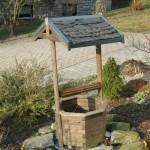 Brunnendach mit Schieferdeckung
